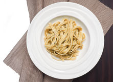 Fettuccine put on a white plate. Stock Photo