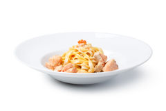 Fettuccine with salmon. And caviar sauce, on a White background royalty free stock images