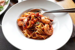 Fettuccine with shrimp and tomatoes Stock Images