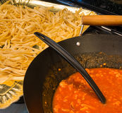 Fettuccine and souce. Fettuccine or tagliatelle cut ready to cook and sauce bolognese Royalty Free Stock Photo