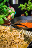 Fettuccine and souce 1. Fettuccine or tagliatelle cut ready to cook and sauce bolognese Royalty Free Stock Image