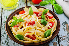 Fettuccine with tomatoes. And parmesan cheese stock photo