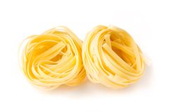 Fettuccini nests Stock Photo