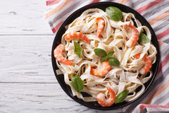 Fettuccini pasta in cream sauce with shrimp. horizontal top view Royalty Free Stock Photos