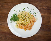 Fettuccini pasta with salmon Royalty Free Stock Images