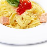 Fettuccini with salmon and creamy sauce Stock Photography