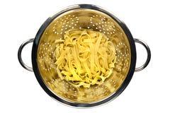 Fettucine in Colander Stock Image
