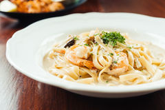 Fettucine white cream sauce with shrimp and mushroom Royalty Free Stock Images