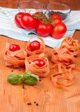 Fettucini με τις ντομάτες Στοκ Εικόνες