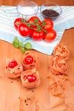 Fettucini con i pomodori Immagine Stock