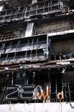 Feuer ausgeweidetes Einkaufszentrum in Bangkok Stockbilder