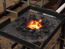 Feuer in einer Schmiede Stockbilder