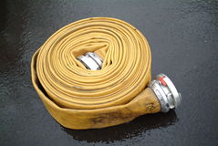 Feuer-Hydrant-Schlauch Stockfotografie