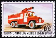 Feuerbekämpfender LKW mit ledder, Reihe, circa 1977 Stockfoto