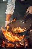 Feuerbrand, kochend auf Eisenstein Lizenzfreie Stockfotografie