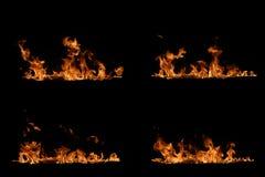 Feuerflammen auf schwarzem Hintergrund Lizenzfreie Stockfotos