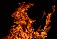 Feuerflammen auf schwarzem Hintergrund Lizenzfreie Stockfotografie