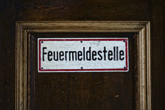 Feuermeldestelle (fire call point) Sign royalty free stock photo