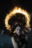Feuerruhm über Meerjungfrau Lizenzfreies Stockfoto