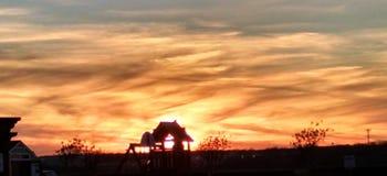 Feuersonnenuntergang Stockfotos
