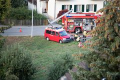 Feuerwehr - fire Department, Einsatzleitung - Mission Control, Sammelplatz - rallying point. Recording of a fire-brigade exercise on a village street stock images