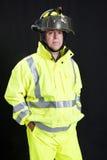 Feuerwehrmann auf Schwarzem Stockfotografie