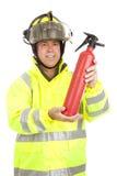 Feuerwehrmann demonstriert Feuerlöscher Stockfoto