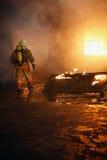 Feuerwehrmann, der geht abzufeuern Stockbilder