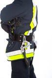 Feuerwehrmann in der Uniform mit seiner Ausrüstung Lizenzfreies Stockbild