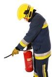 Feuerwehrmann mit Feuerlöscher Stockbilder