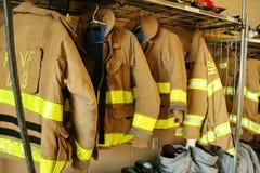 Feuerwehrmannmäntel Stockbild