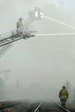 Feuerwehrmänner und Eisenbahn-Spuren Lizenzfreies Stockbild