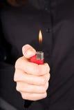 Feuerzeug auf schwarzem Hintergrund Lizenzfreies Stockfoto