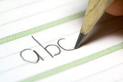 Feuille avec l'ABC d'écriture de main photographie stock