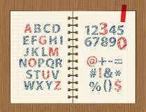 Feuille avec le croquis des lettres et des symboles Photos libres de droits