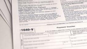 Feuille d'impôt 1040-V banque de vidéos