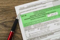 Feuille d'impôt polonaise avec le stylo Photos stock