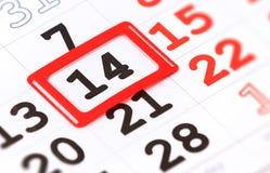 Feuille de calendrier mural avec la marque rouge le 14 février Image libre de droits