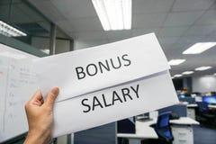 Feuille de paie de bonification et de salaire photos stock