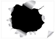 Feuille de papier avec le trou loqueteux noir Photographie stock