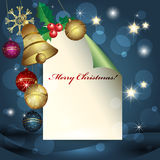 Feuille de papier, de billes de Noël et de cloche Images stock