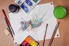 Feuille de peinture d'aquarelle sur la table Images libres de droits