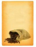 Feuille de vieux papier avec le motif renversé de café Photo stock