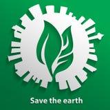 Feuille verte à l'intérieur de la terre et du bâtiment autour Images stock