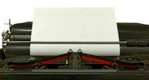 Feuille vide dans la machine à écrire de style ancien (d'isolement) Photos libres de droits