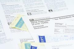 Feuilles d'impôt des USA IRS Photographie stock libre de droits