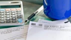Feuilles d'impôt françaises Photos stock