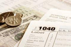 Feuilles d'impôt 1040 pour l'IRS Photographie stock