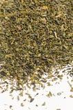 Feuilles de thé vertes sèches Photographie stock libre de droits
