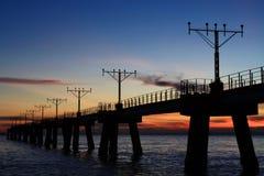 Feux d'approche et coucher du soleil Photographie stock